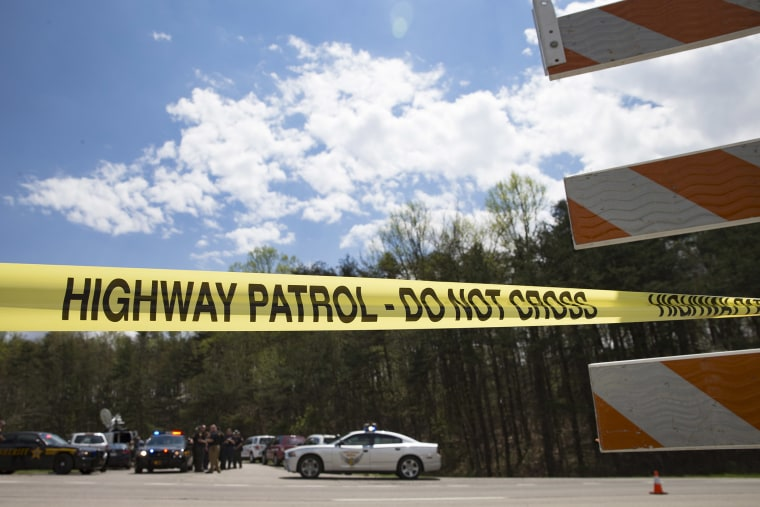 Police tape is deployed across from the Union Hill Road exit off Route 32 at a crime scene perimeter, April 22, 2016, in Pike County, Ohio. (Photo by John Minchillo/AP)