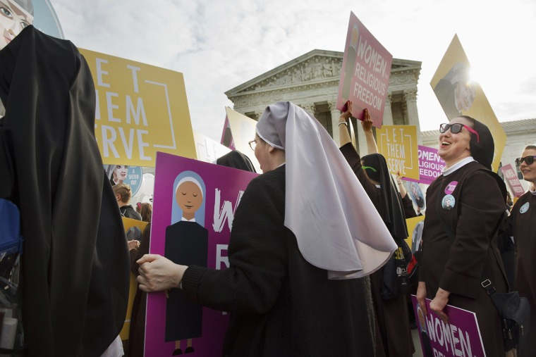 Nuns of the Order of St. Francis, from Mishawaka, Ind., rally outside the Supreme Court in Washington, March 23, 2016. (Photo by Jacquelyn Martin/AP)