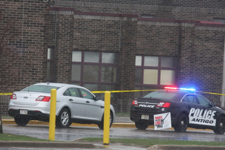 Two Antigo police department vehicles sit in front of the entrance to Antigo High School, April 24, 2016, where an 18-year-old gunman opened fire late Saturday outside of a prom at the school. (Photo by Fred Berner/Antigo Daily Journal/AP)