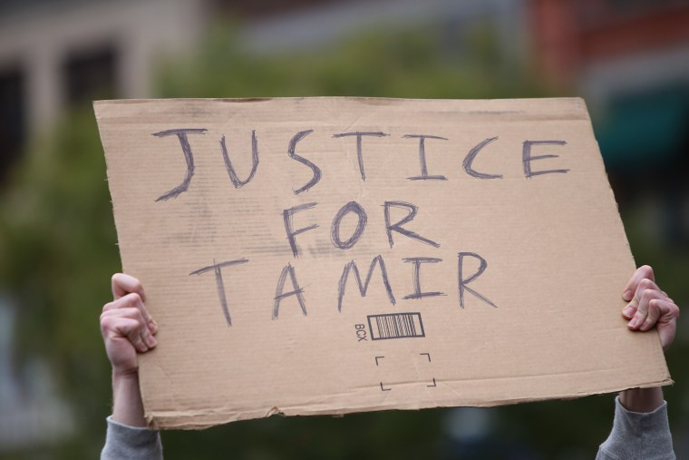 """A """"Justice for Tamir"""" sign is held aloft on Nov. 22, 2015. (Photo by Andy Katz/Pacific Press/Sipa/AP)"""