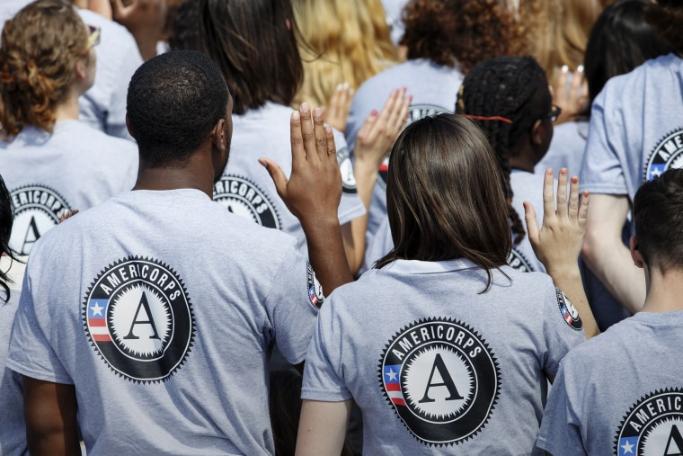 Hundreds of new AmeriCorps volunteers are sworn in for duty at a ceremony, Sept. 12, 2014, on the South Lawn of the White House in Washington. (Photo by J. Scott Applewhite/AP)