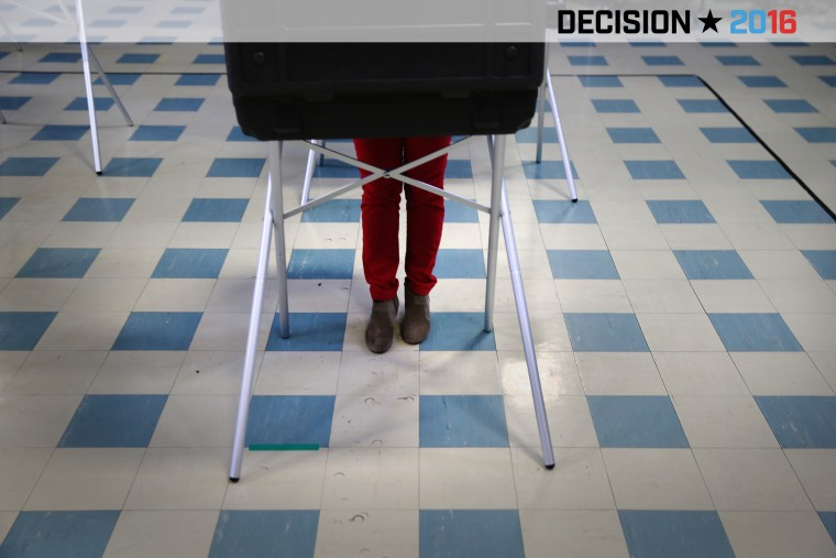 A voter fills out her ballot at a polling center on April 26, 2016 in Stamford, Conn. (Photo by John Moore/Getty)