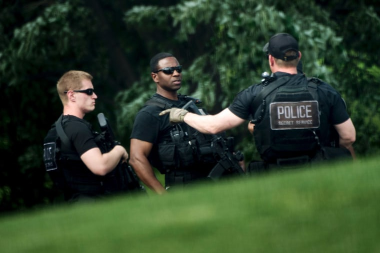 Heavily armed members of the Secret Service patrol on the North Lawn of the White House during a security lockdown April 26, 2016 in Washington, DC. (Photo by Brendan Smialowski/AFP/Getty)