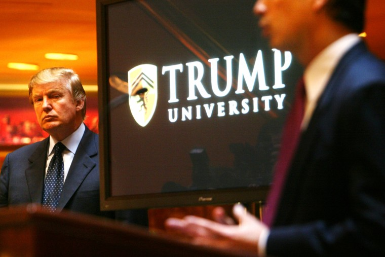 Real estate mogul and TV star Donald Trump listens as Michael Sexton introduces him to announce the establishment of Trump University at a press conference in New York, May 23, 2005. (Photo by Bebeto Matthews/AP)