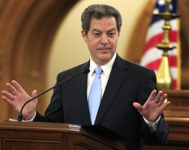 In this Jan. 12, 2016 file photo, Kansas Gov. Sam Brownback speaks to the legislature in Topeka, Kan. (Photo by Orlin Wagner/AP)