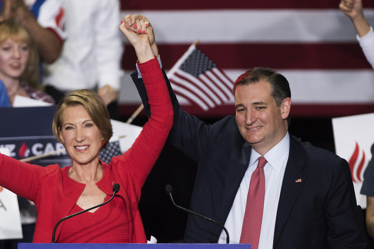 Republican presidential candidate Sen. Ted Cruz (R-TX) holds up hands his new running mate, Carly Fiorina, at a campaign rally at the Pan Am Plaza on April 27, 2016 in Indianapolis, Ind. (Photo by Ty Wright/Getty)
