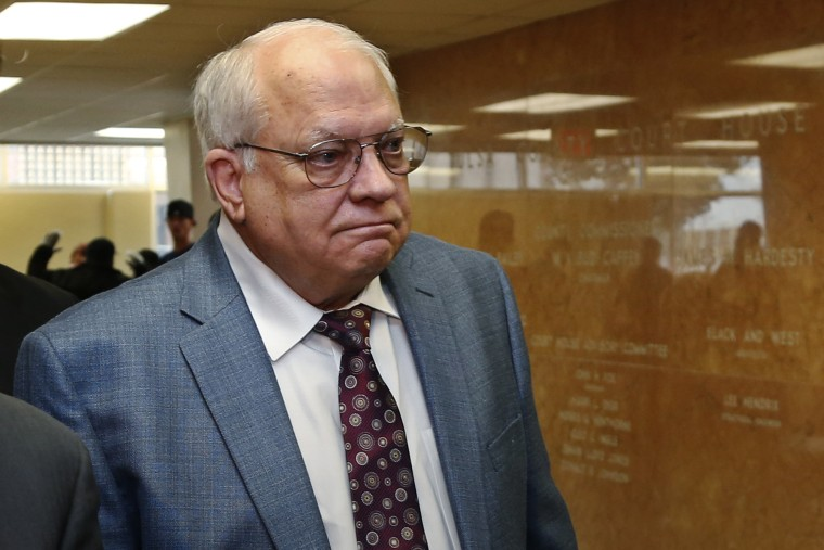 In this Tuesday, April 21, 2015 file photo, Robert Bates arrives for his arraignment at the Tulsa County courthouse in Tulsa, Okla. (Photo by Sue Ogrocki/AP)