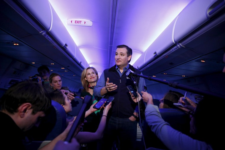 U.S. Republican presidential candidate Ted Cruz and his wife Heidi speak to the press aboard a plane en route to a campaign event in Piedmont, S.C., Feb. 2, 2016. (Photo by Eric Thayer/Reuters)