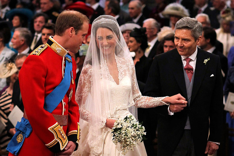 Prince William speaks to his bride, Catherine Middleton as she holds the hand of her father Michael Middleton at Westminster Abbey on April 29, 2011 in London, England. (Photo by Dominic Lipinski/WPA Pool/Getty)