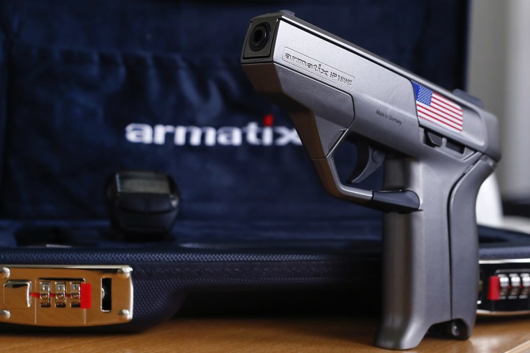 A smart gun by Armatix is pictured at the Armatix headquarters in Munich May 14, 2014. (Photo by Michael Dalder/Reuters)