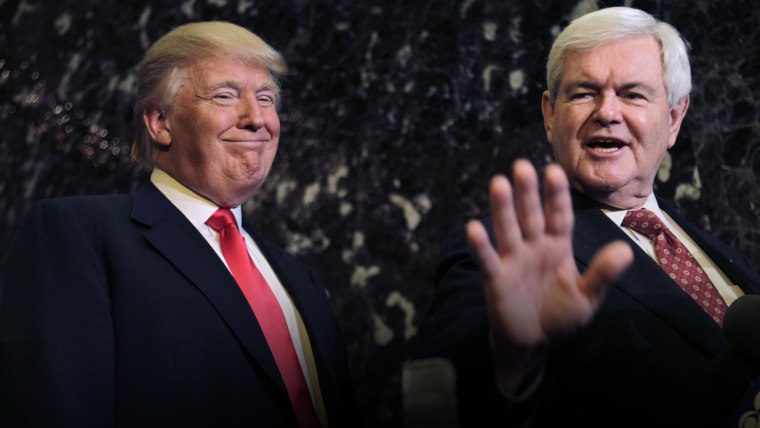 Donald Trump smiles at left as former House Speaker Newt Gingrich talks to media after their meeting in New York, Dec. 5, 2011. (Photo by Seth Wenig/AP)