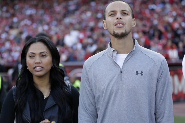 Golden State Warriors player Stephen Curry and his wife Ayesha Curry watch as the San Francisco 49ers play the Carolina Panthers during the third quarter of an NFL football game in San Francisco, Nov. 10, 2013. (Photo by Marcio Jose Sanchez/AP)