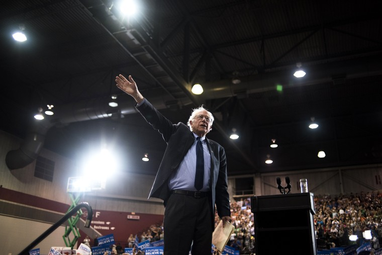 Democratic presidential candidate Senator Bernie Sanders (I-Vt.) waves at attendees during a campaign event in Huntington, W. Va., on April 26, 2016. (Photo by Ty Wright/Bloomberg/Getty)