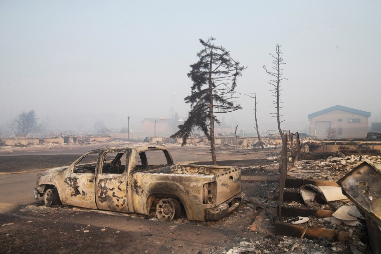 Home foundations and shells of vehicles are nearly all that remain in a residential neighborhood destroyed by a wildfire on May 6, 2016 in Fort McMurray, Alberta, Canada. (Photo by Scott Olson/Getty)
