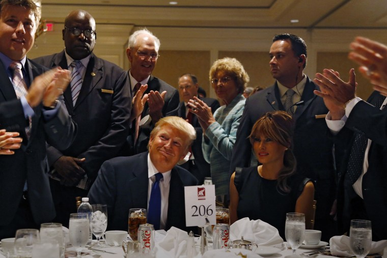Donald Trump and his wife Melania are applauded before a dinner hosted by the Sarasota Republican Party honoring him as Statesman of the Year in Sarasota, Fla., August 26, 2012. (Photo by Mike Carlson/Reuters)