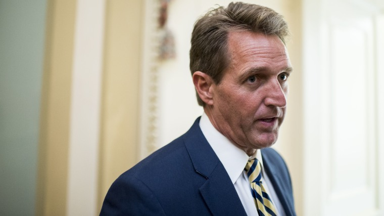 Sen. Jeff Flake, R-Ariz., stops to speak with a reporter as he arrives for the Senate Republicans' policy luncheon, May 12, 2015. (Photo By Bill Clark/CQ Roll Call/AP)