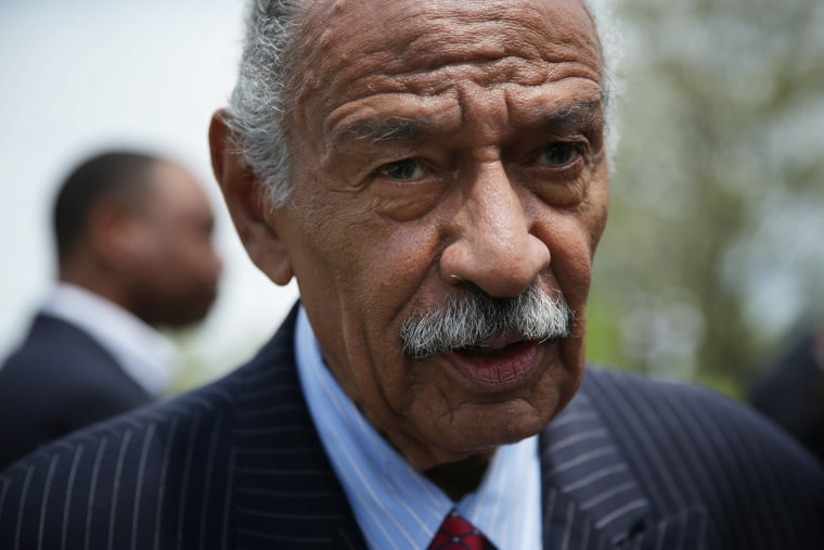 """U.S. Rep. John Conyers (D-MI) speaks to a reporter at the end of a news conference April 22, 2015 on Capitol Hill in Washington, DC. Rep. Conyers held the news conference to discuss the \""""End Racial Profiling Act.\"""" (Photo by Alex Wong/Getty)"""