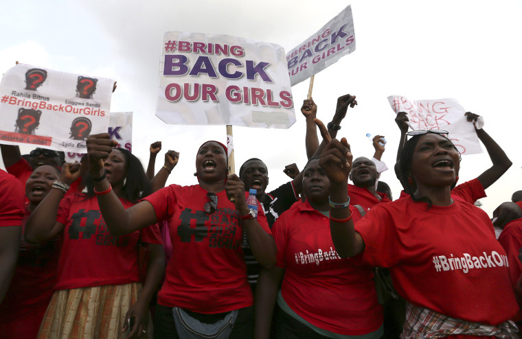 """The Abuja wing of the """"Bring Back Our Girls"""" protest group march calling for the release of the Nigerian schoolgirls in Chibok who were kidnapped by Islamist militant group Boko Haram, on May 22, 2014. (Photo by Afolabi Sotunde/Reuters)"""