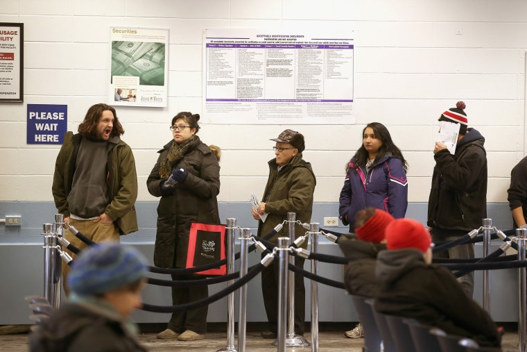 Illinois residents wait in line to apply for or renew their driver's license at a driver services facility on Dec. 10, 2013. (Photo by Scott Olson/Getty)