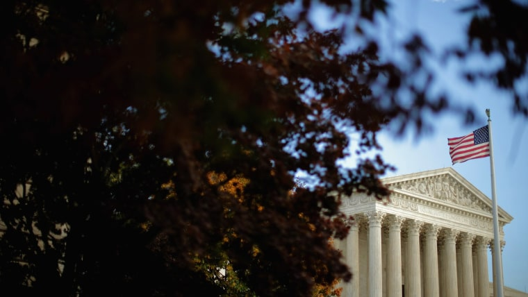 The United States Supreme Court building is framed by fall foliage Nov. 6, 2015 in Washington, DC. (Photo by Chip Somodevilla/Getty)