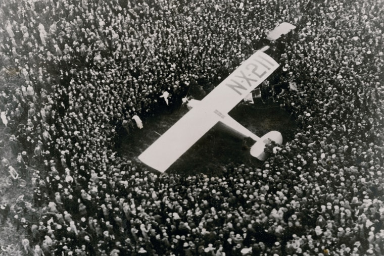 The Spirit of St. Louis is surrounded by a crowd after aviator Charles A. Lindbergh completed the first nonstop transatlantic flight at Le Bourget Airfield near Paris, France, May 21, 1927. (Photo via Xinhua/Corbis/Nat Geo/Christie's Images/ZUMA)