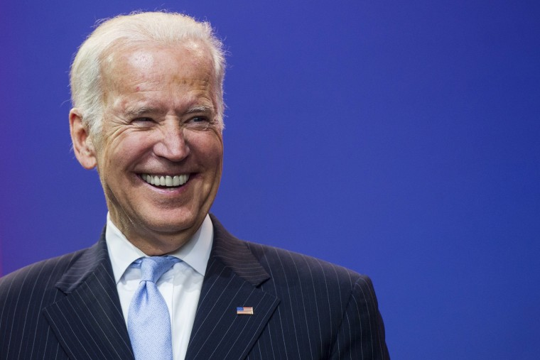 Vice President Joe Biden laughs during a celebration of the 5th anniversary of Joining Forces and the 75th anniversary of the USO at Andrews Air Force Base in Md., May 5, 2016. (Photo by Saul Loeb/AFP/Getty)