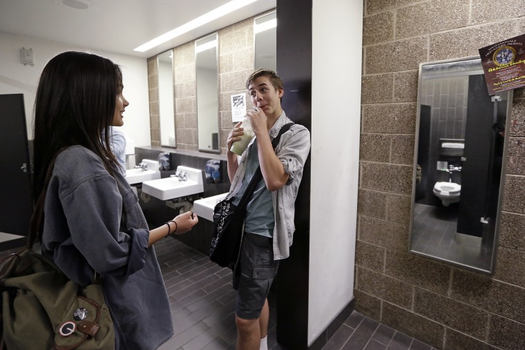 Ninth graders Tehya Vining, left, and Christian Jarboe talk after walking for the first time into a gender neutral bathroom at Nathan Hale high school, May 17, 2016, in Seattle. (Photo by Elaine Thompson/AP)