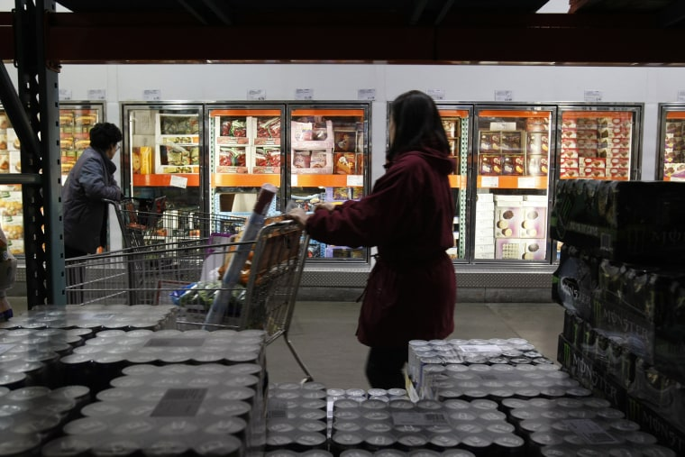 Shoppers peruse the frozen foods section at Costco in Mountain View, Calif. (Photo by Paul Sakuma/AP)