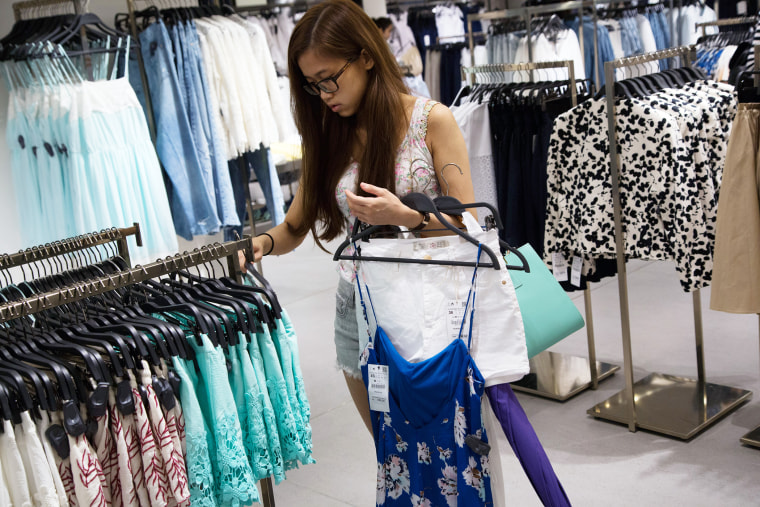 A customer browses clothes at a Zara store in China, on June 24, 2014. (Photo by Lam Yik Fei/Bloomberg/Getty)