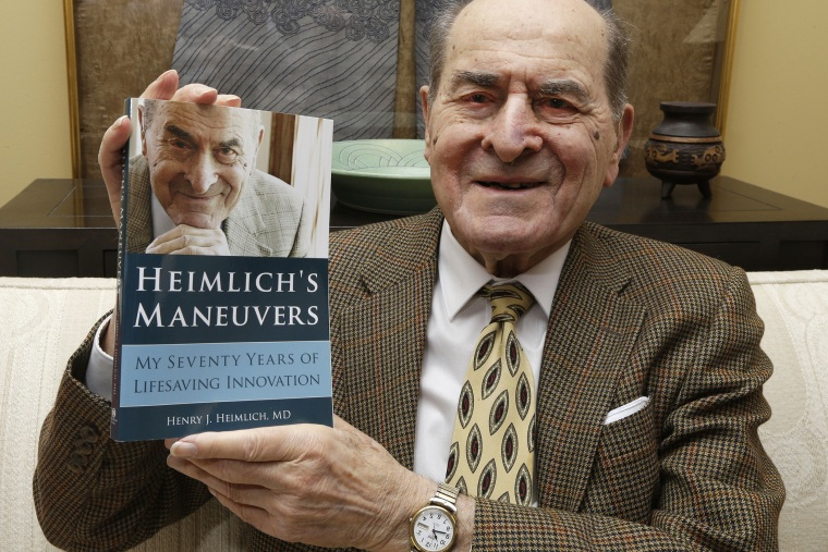 In this Wednesday, Feb. 5, 2014 photo, Dr. Henry Heimlich holds his memoirs prior to being interviewed at his home in Cincinnati. (Photo by Al Behrman/AP)