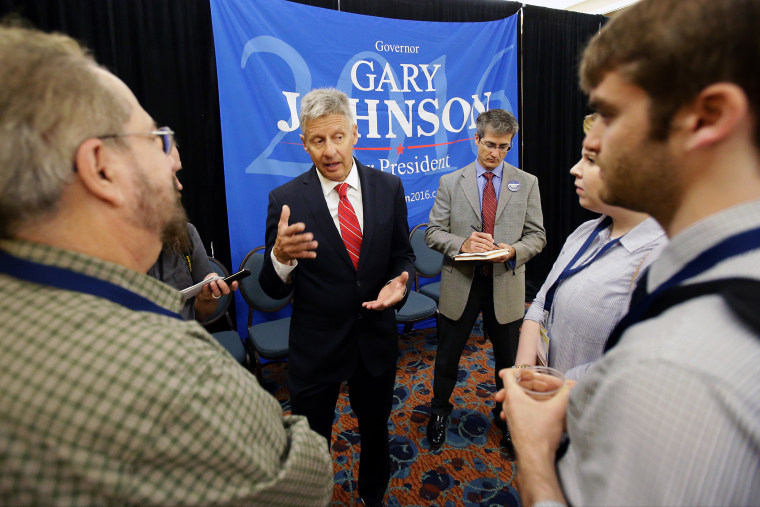 Libertarian presidential candidate Gary Johnson, center, speaks to supporters and delegates at the National Libertarian Party Convention, May 27, 2016, in Orlando, Fla. (Photo by John Raoux/AP)
