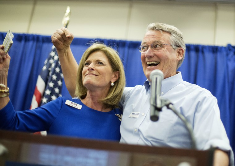 Georgia Republican U.S. Congressman Rick Allen, cheers with wife Bettie at a campaign event for Georgia Republican U.S. Senate candidate David Perdue, Wednesday, Oct. 29, 2014, in Augusta, Ga.