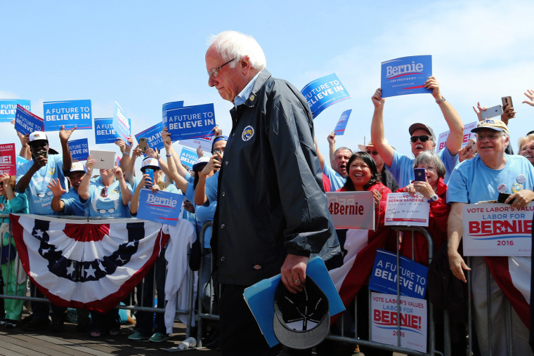 Democratic presidential candidate Bernie Sanders makes his way to the podium to address supporters outside the Los Angeles Maritime Museum in San Pedro, Calif., May 27, 2016. (Photo by Mike Nelson/EPA)