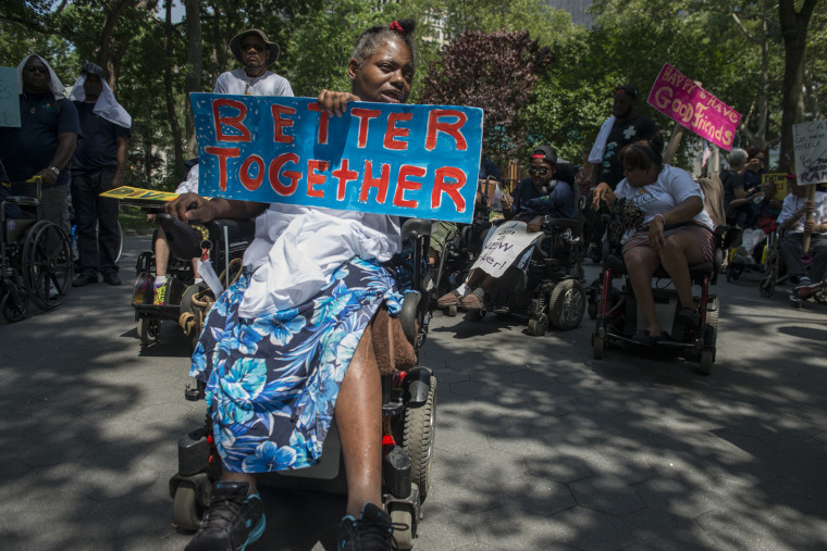 People participate in the first annual Disability Pride Parade on July 12, 2015 in New York City. (Photo by Stephanie Keith/Getty)