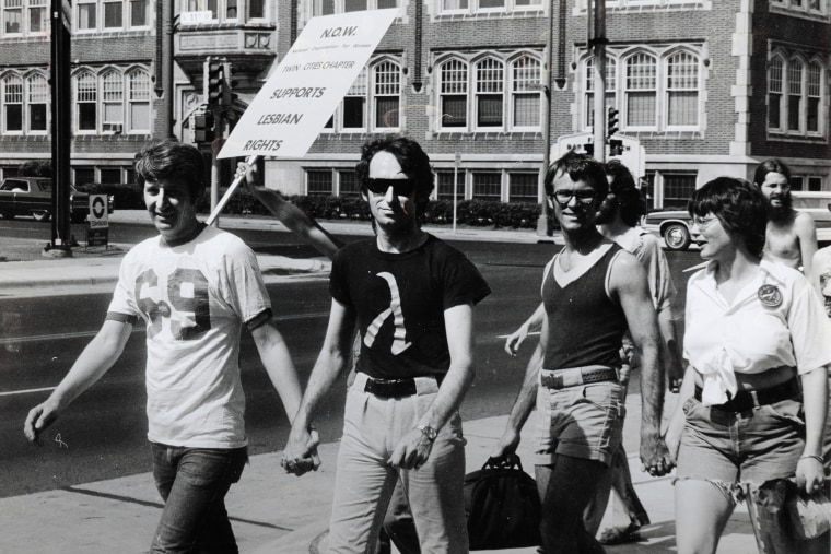 Jack Baker and Michael McConnell, the first same-sex married couple in Minnesota, participate in a Pride Parade in Minneapolis, 1974. (Courtesy of the Jean-Nickolaus Tretter Collection in GLBT Studies/University of Minnesota Libraries)