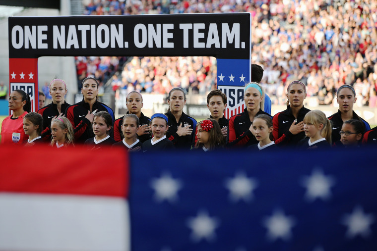The United States Women's National Soccer Team observe the national anthem as they prepare to face Japan during an international friendly match at Dick's Sporting Goods Park on June 2, 2016 in Commerce City, Colo. (Photo by Doug Pensinger/Getty)