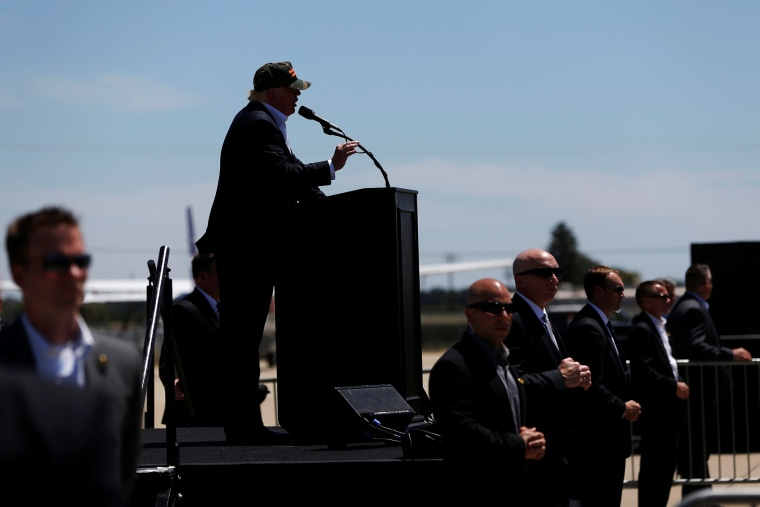 Security personnel stand guard as Republican U.S. presidential candidate Donald Trump speaks at a campaign rally in Redding, Calif. on June 3, 2016. (Photo by Stephen Lam/Reuters)
