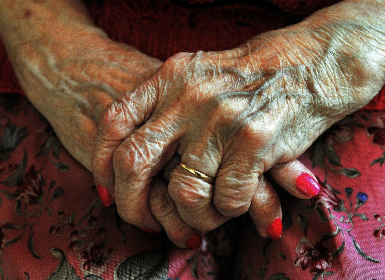 The hands of an elderly woman. (Photo by John Stillwell/PA Wire/AP)