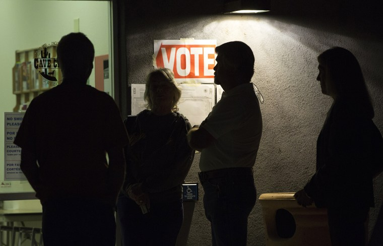 Early morning voters stand in line before sunrise to vote, March 22, 2016. (Photo by Nancy Wiechec/Reuters)