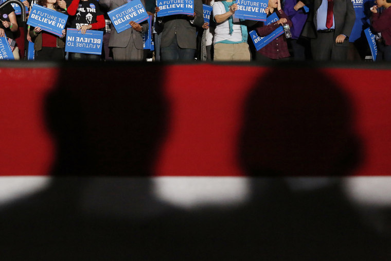 Shadows loom over supporters of Democratic presidential candidate Bernie Sanders at his 2016 New Hampshire presidential primary night rally in Concord, N.H., Feb. 9, 2016. (Photo by Shannon Stapleton/Reuters)