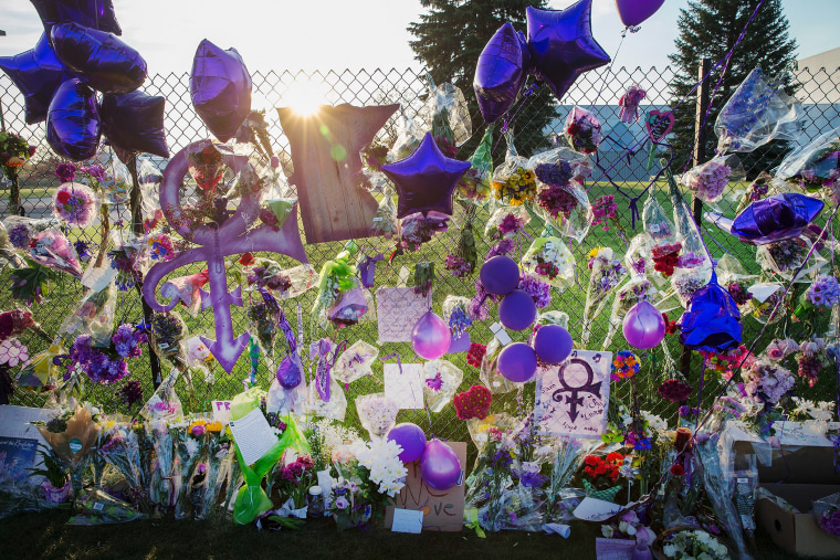 Mementos left by fans are attached to the fence which surrounds Paisley Park, the home and studio of Prince, on April 23, 2016 in Chanhassen, Minn. (Photo by Scott Olson/Getty)