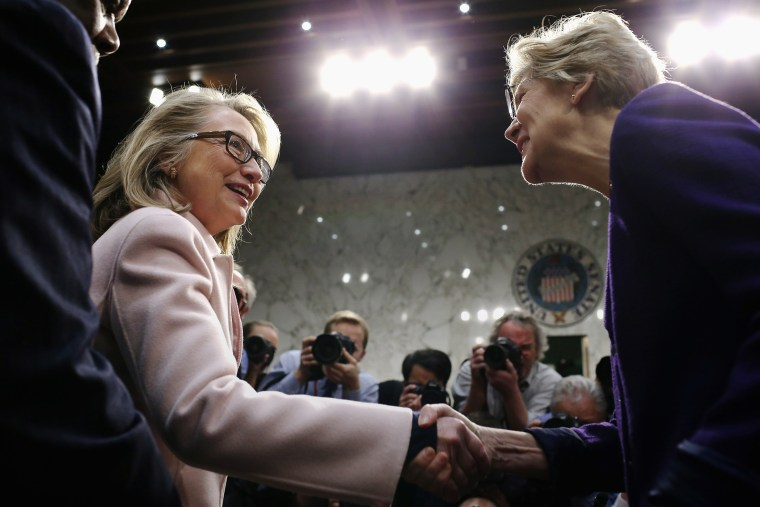 Hillary Clinton greets Sen. Elizabeth Warren as they arrive for Sen. John Kerry's confirmation hearing in the Hart Senate Office Building on Capitol Hill Jan. 24, 2013 in Washington, DC. (Photo by Chip Somodevilla/Getty)