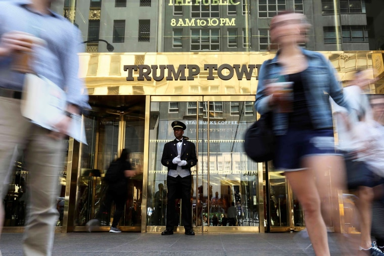 A doorman stands as people walk past the Trump Tower in N.Y. on May 23, 2016. (Photo by Carlo Allegri/Reuters)