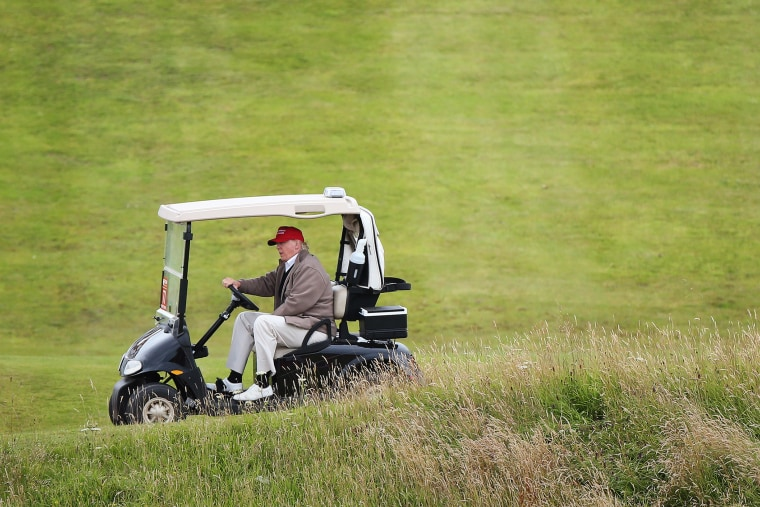 In this July 31, 2015 file photo, Republican presidential candidate Donald Trump drives his golf buggy on the Turnberry golf course in Turnberry, Scotland. (Photo by Scott Heppell/AP)