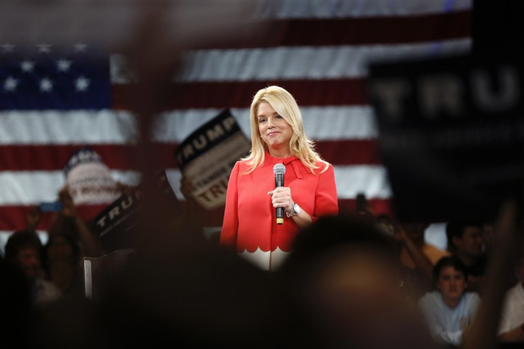 Fla. Attorney General Pam Bondi makes introductory remarks for Republican presidential candidate Donald Trump, before Trump arrives at a campaign event in Tampa, Fla. on March 14, 2016. (Photo by Gerald Herbert/AP)