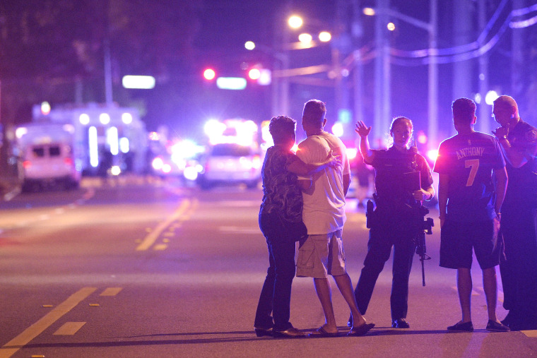 Orlando Police officers direct family members away from a fatal shooting at Pulse Orlando nightclub in Orlando, Fla., June 12, 2016. (Photo by Phelan M. Ebenhack/AP)