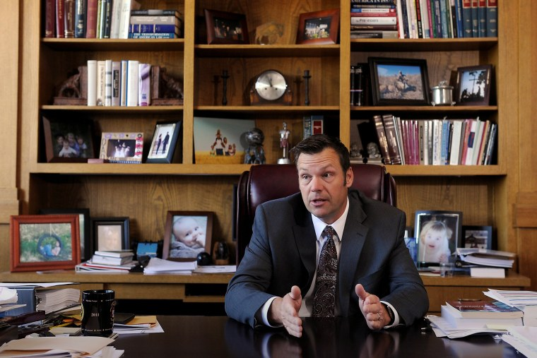 Kansas Secretary of State Kris Kobach talks about the Kansas voter ID law in his Topeka, Kan., office May 12, 2016. (Photo by Dave Kaup/Reuters)