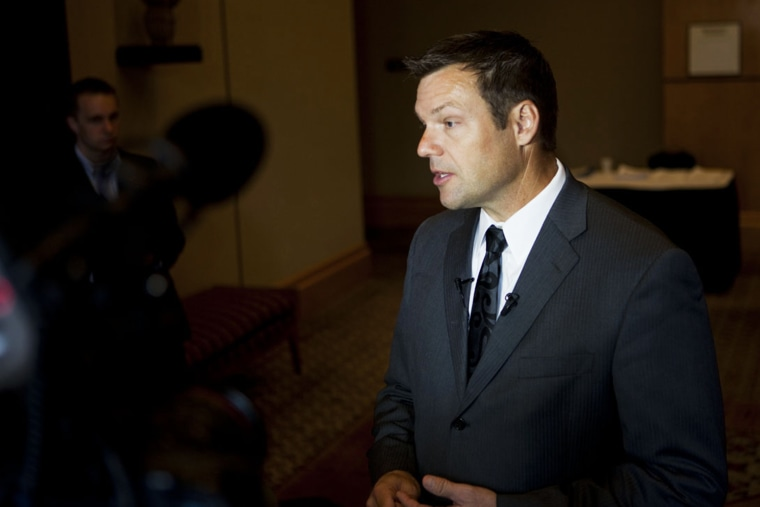 Kris Kobach fields questions from reporters in Birmingham, Ala. on Aug. 17, 2012. (Photo by Bob Miller for NBC News)