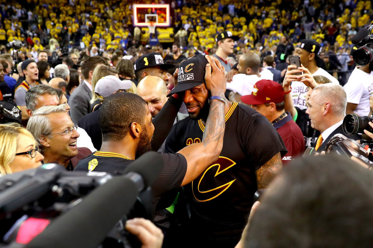 LeBron James #23 and Kyrie Irving #2 of the Cleveland Cavaliers celebrate after defeating the Golden State Warriors 93-89 in Game 7 of the 2016 NBA Finals at ORACLE Arena on June 19, 2016 in Oakland, Calif. (Photo by Ezra Shaw/Getty)