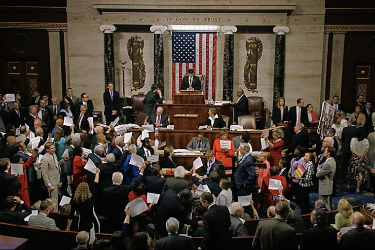 In this image from video provided by House Television, House Speaker Paul Ryan stands at the podium as he brings the House into session in the night of June 22, 2016, in Washington. (Photo by House Television/AP)